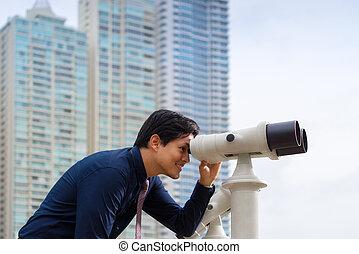 affaires asiatiques, homme jumelles, regarder, ville