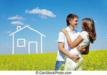 Affection - Image of happy couple embracing in meadow with ...