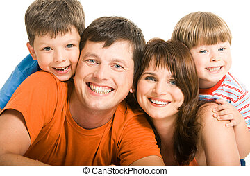 Affection - Portrait of joyful family laughing and looking...