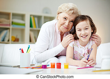 Affection - Portrait of happy girl and her grandmother...