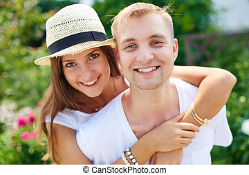 Affection - Joyful couple looking at camera