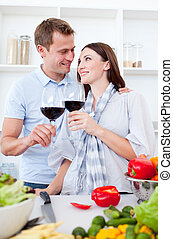 Affectionate couple drinking wine while cooking