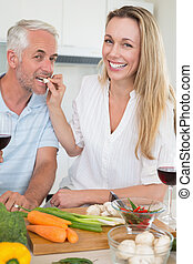 Affectionate couple preparing dinne