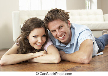 Affectionate Couple Relaxing At Home Together