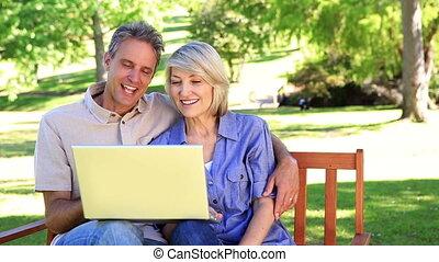 Affectionate couple sitting on par