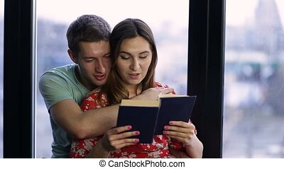 Affectionate couple spending time together reading