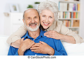 Affectionate elderly couple with beautiful beaming friendly...