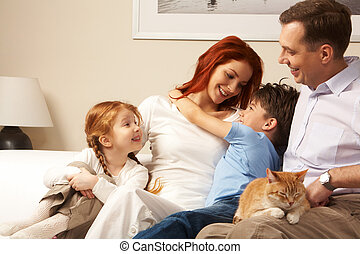 Affectionate family - Photo of cute boy embracing his pretty...