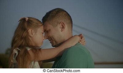 Affectionate father bonding with his daughter - Portrait of...