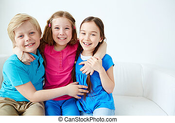 Affectionate kids - Three little friends looking at camera...