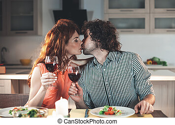Affectionate man and woman having romantic dinner
