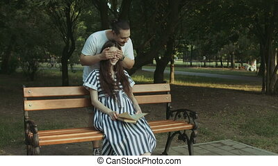 Affectionate man embracing his pregnant wife in park