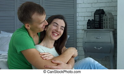 Affectionate man embracing woman from behind
