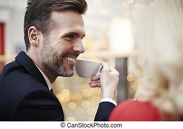 Affectionate man with woman having coffee