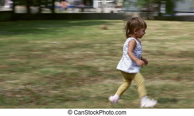 Affectionate mom - Lovely little girl running to her mom who...