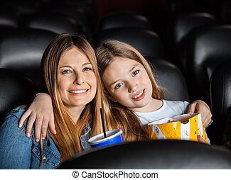 Affectionate Mother And Daughter In Theater