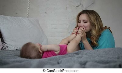 Affectionate mother bonding with infant child