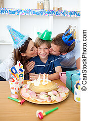 Affectionate parents celebrating their son\'s birthday