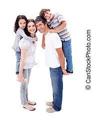 Affectionate parents giving their children a piggyback ride
