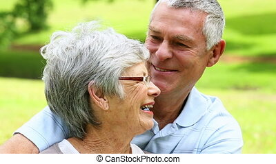 Affectionate senior couple relaxing