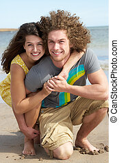 Affectionate Young Couple Having Fun On Beach