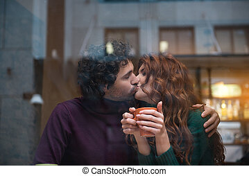 Affectionate young man and woman having romantic kiss