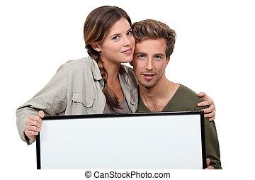affiche, couple, heureux, tenue, vide