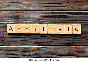 AFFILIATE word written on wood block. AFFILIATE text on wooden table for your desing, concept