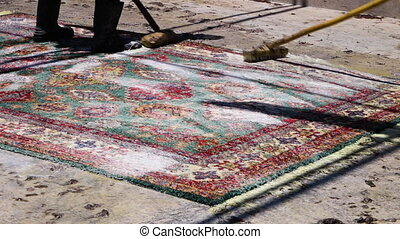 Afghan carpets being cleaned - A medium shot of a carpet...