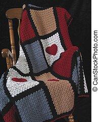 Afghan in Rocker - Cozy crocheted afghan sitting in a wooden...