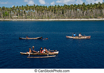 Afloat - Three canoes with locals, Mayu Island, Indonesia