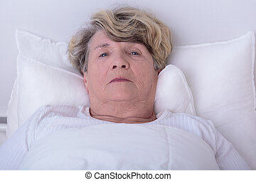 Afraid elder woman - Elder woman is alone and afraid in the...
