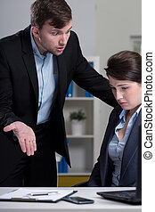 Afraid female employee - Young afraid female employee and...