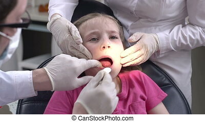 Afraid of Pain - Little girl stressed at dental check-up,...