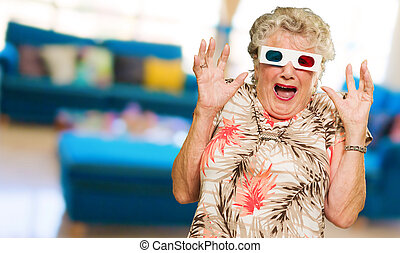 Afraid Senior Woman Watching 3d Movie Screaming, Indoors