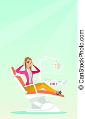 Afraid woman sitting in the dental chair. - Frightened...