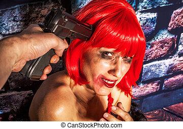 Afraid woman with gun