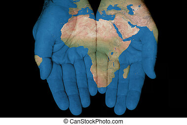 Africa In Our Hands - Map painted on hands showing concept...