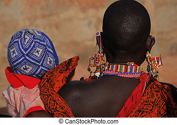 Masai woman with jewelry end baby