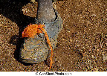 africa - African boy with broken shoes