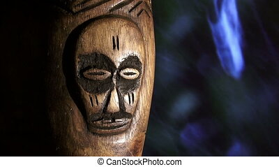Africa, wood face, rain