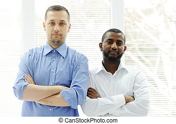 African American and Caucasian business man together