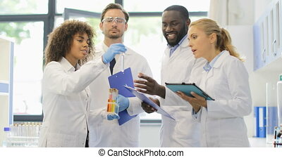 African American Assistant Woman Show Team Of Scientists...