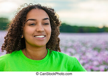 African American Biracial Young Woman Girl Teenager in Field of Flowers