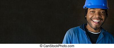 African American black man industial worker on blackboard background