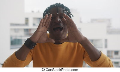 African american black man shouting WOW using his hands to amplify his voice. High quality 4k footage