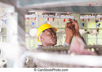 african american blue collar worker working in textile ...