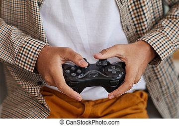 African-American Boy Holding Gamepad Close Up