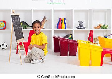 african american boy in preschool classroom