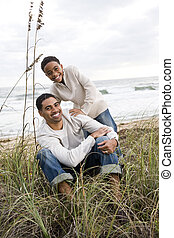 African-American boy with father on at beach